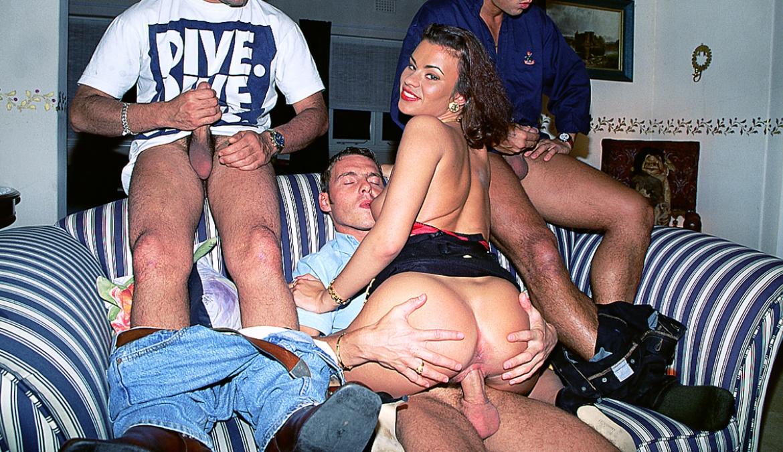 Miss Julia Takes on Three Hard Cocks in This Gangbang Scene